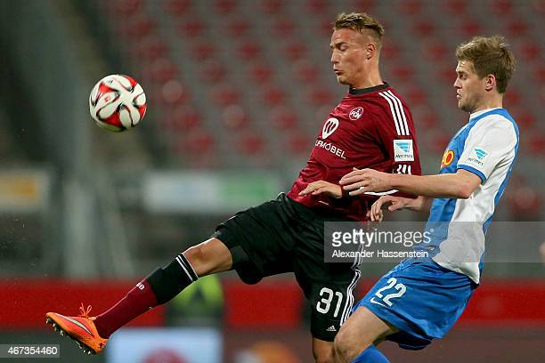 Ondrej Petrak of Nuremberg is challenged by Simon Terodde of Bochum during the Second Bundesliga match between 1 FC Nuernberg and VfL Bochum at...