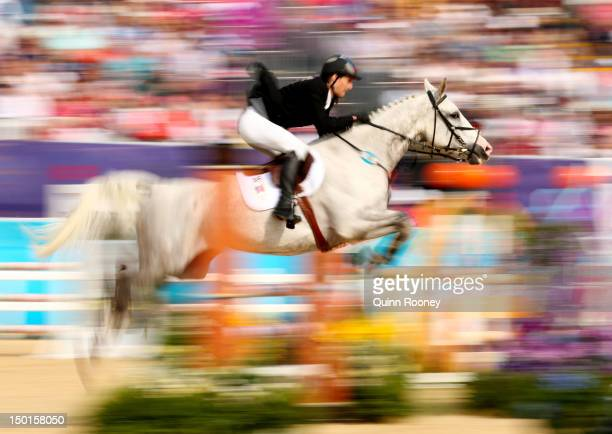 Ondrej Polivka of Czech Republic riding Umberto de Fauquez competes in the Riding Show Jumping during the Men's Modern Pentathlon on Day 15 of the...