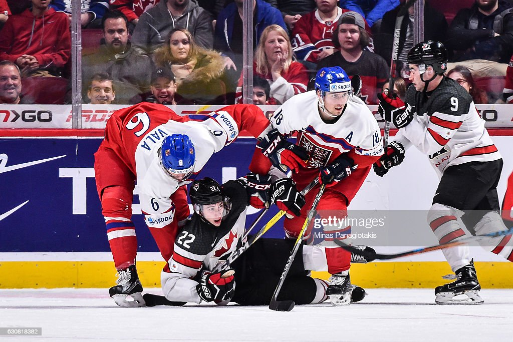 Ondrej Vala #6 of Team Czech Republic takes down Anthony Cirelli #22 of Team Canada during the 2017 IIHF World Junior Championship quarterfinal game at the Bell Centre on January 2, 2017 in Montreal, Quebec, Canada. Team Canada defeated Team Czech Republic 5-3.