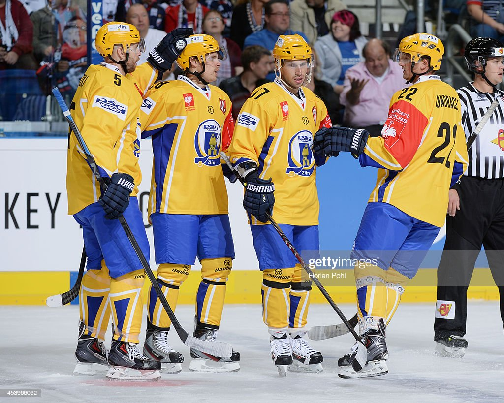 Ondrej Vesely #87 of PSG Zlin celebrates with team-mates after scoring the second goal during the Champions Hockey League group stage game between Eisbaeren Berlin and HC Zlin on August 22, 2014 in Berlin, Germany.