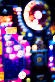 One arm bandit slot machine in casino at night blurred photograph.