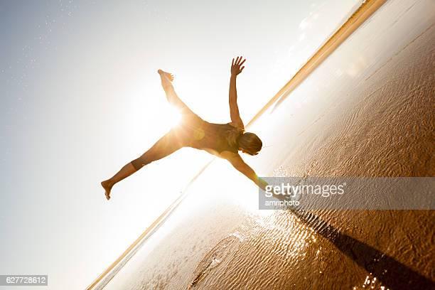 one armed cartwheel on wet beach