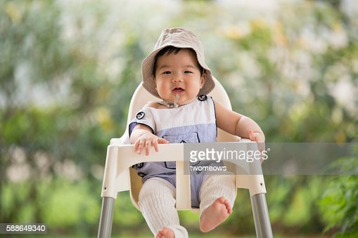 One asian Chinese baby toddler sitting on baby chair.