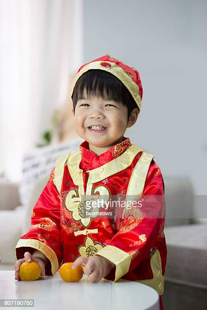 One asian Chinese toddler in Chinese new year traditional clothing.