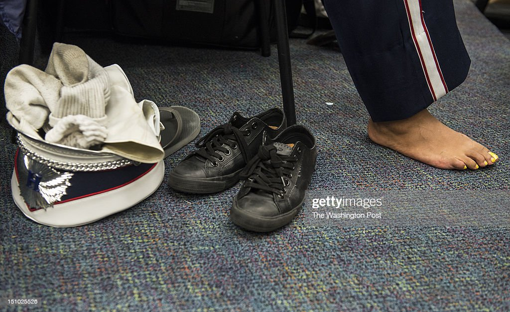 One band member sheds her shoes when the Howard University Showtime Marching Band goes inside to practice the music even more Wednesday August 29, 2012 in Washington, DC.