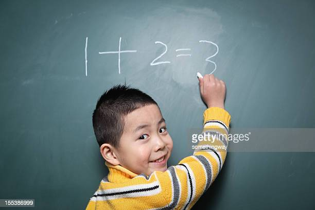 one boy is doing the math question