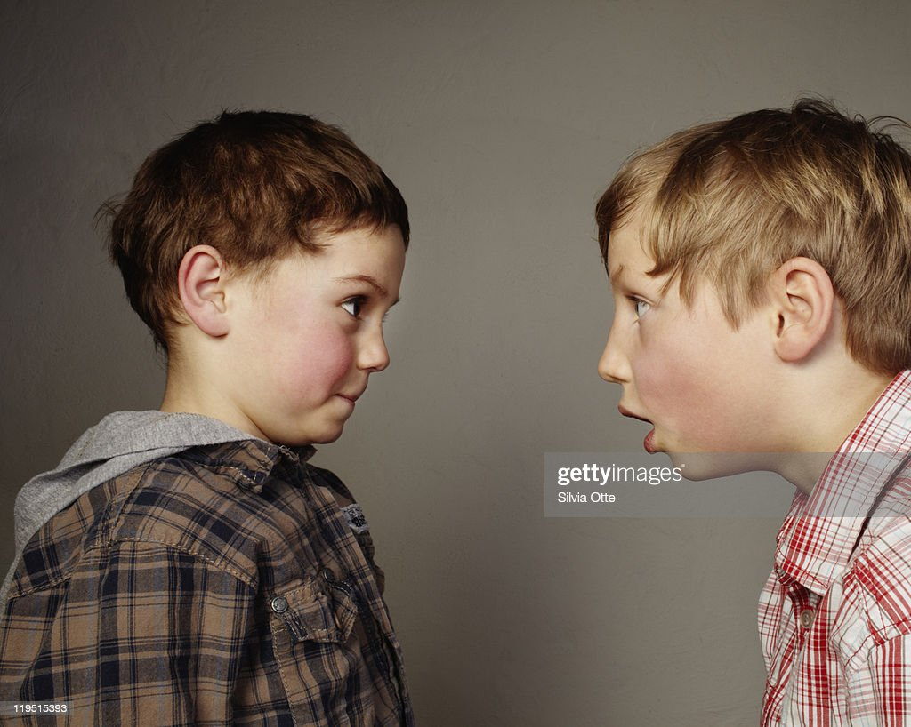 one boy staring at another : Stock Photo