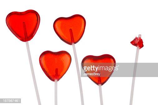 One Broken Heart; Red Heart-Shaped Lollipops, White Background