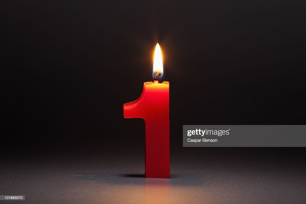 One Candle In The Shape Of The Number 1