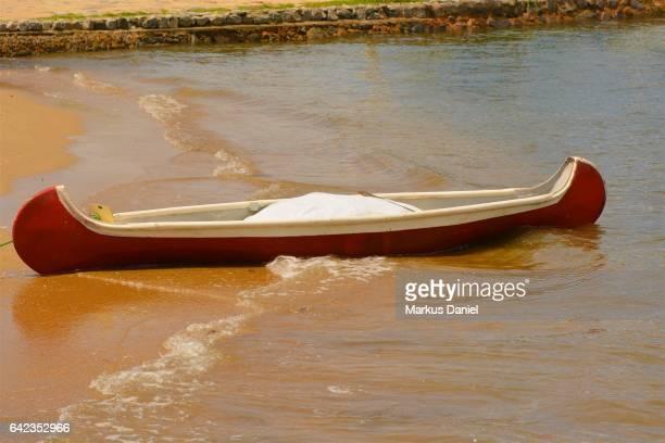 One canoe on the beach in the town of Paraty, Rio de Janeiro