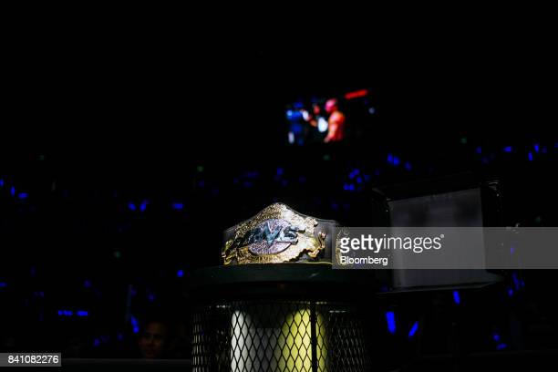 A One Championship belt sits near the cage during The One Kings Conquerors event at the Venetian Macao in Macau on Saturday Aug 5 2017 Sityodtong...