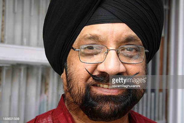 One Cheerful Senior Indian Sikh Man