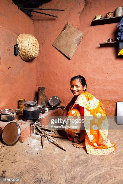 One Cheerful Traditional Rural Indian Woman preparing food