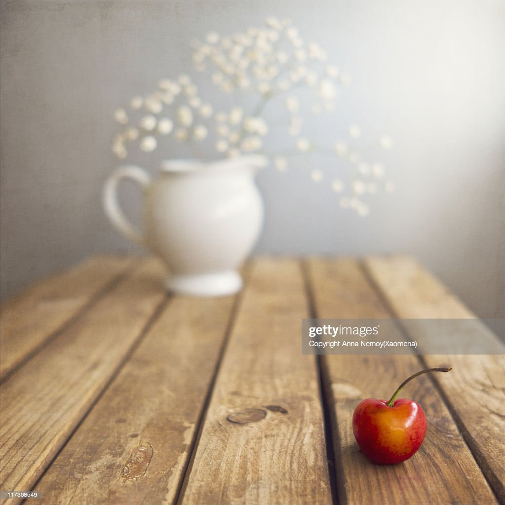 One cherry on table : Stock Photo