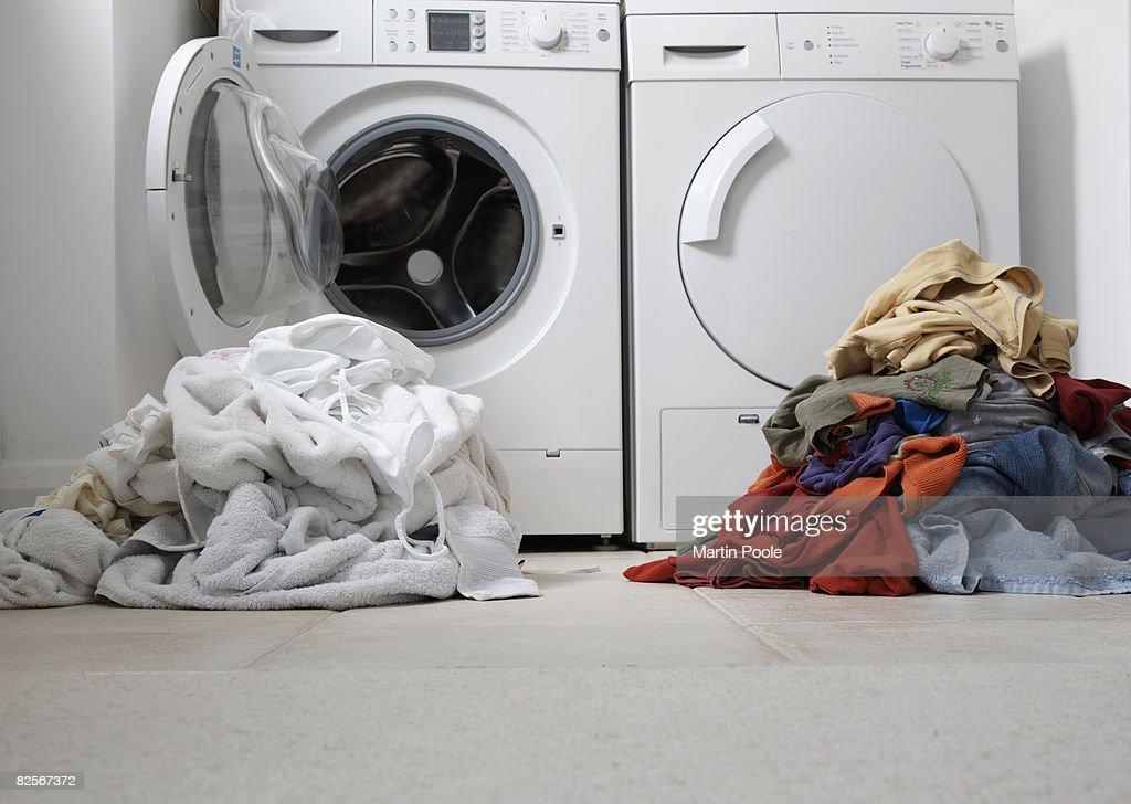one coloured one white pile of washing : Stock Photo
