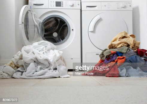 one coloured one white pile of washing