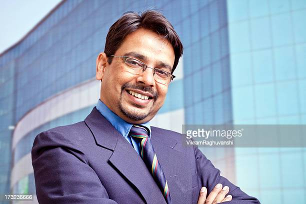 One Confident Cheerful Indian Businessman in Front of Office Building