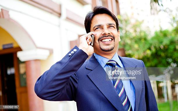 One Confident Cheerful Indian Businessman Talking on the Phone