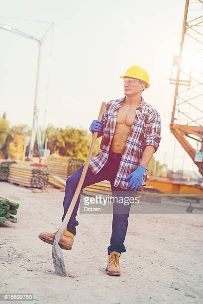 One construction worker near planks and construction crane