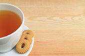 One Cup of Hot tea and Cookies on Natural Wooden Table, with Free Space for Text and Design