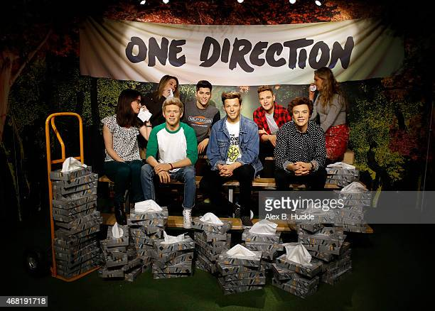 One Direction fans Tansy RatcliffeJames Laura Tokely and Lindsay Ringette wipe away tears at Madame Tussauds following the news of the departure of...