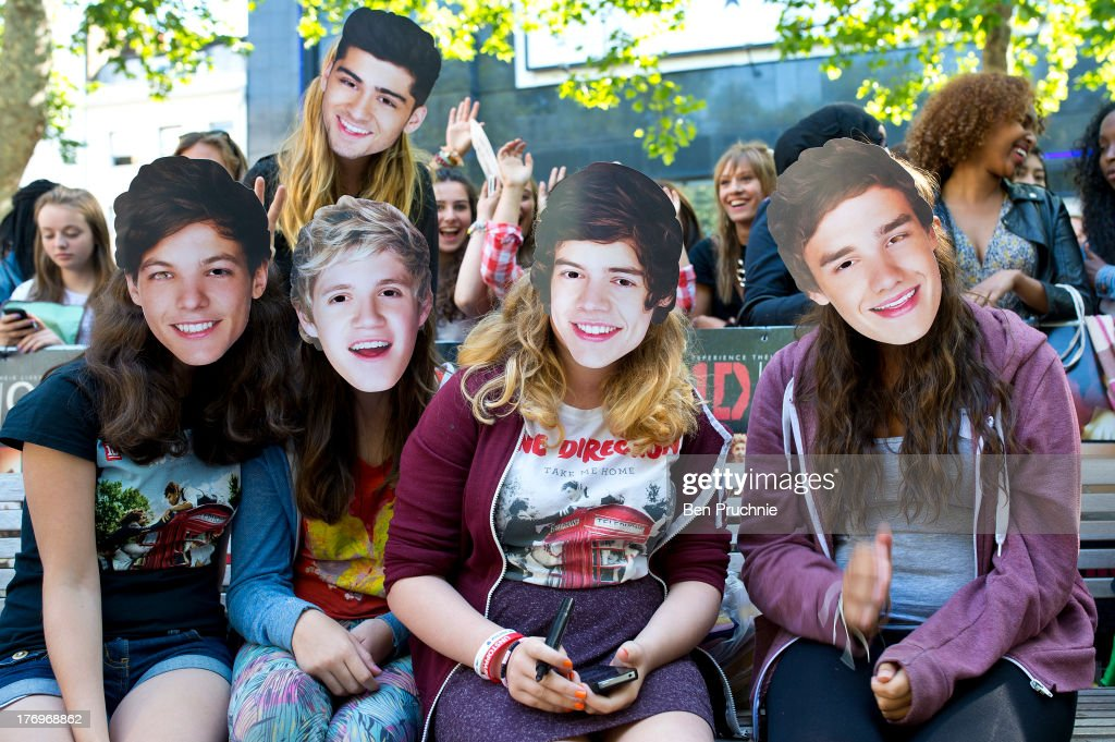 One Direction Fans wearing One Direction masks camp in Leicester Square ahead of the bands London Premiere for 'This Is Us' on August 19, 2013 in London, England.