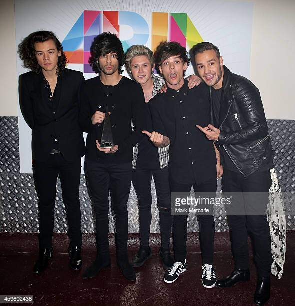 One Direction Harry Styles Zayn Malik Niall Horan Louis Tomlinson and Liam Payne pose for a portrait backstage during the 28th Annual ARIA Awards...