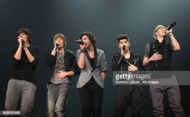 One Direction Louis Tomlinson Liam Payne Harry Styles Zayn Malik and Niall Horan peform for the X Factor Live tour at Wembley Arena London