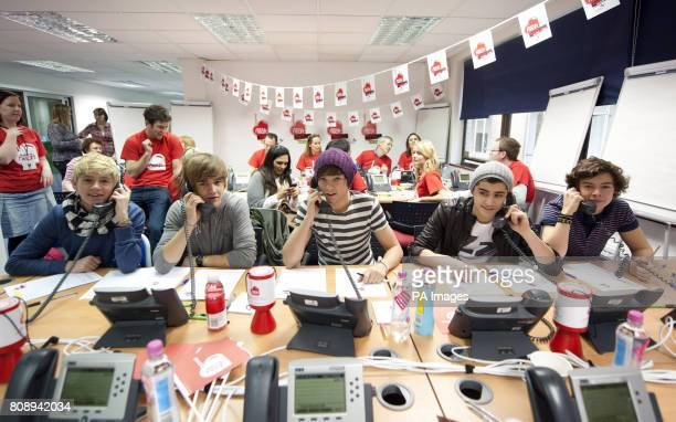 Niall Horan Liam Payne Louis Tomlinson Zayn Malik and Harry Styles manning the telephones during the 2011 Have a Heart appeal Heart FM's charity...