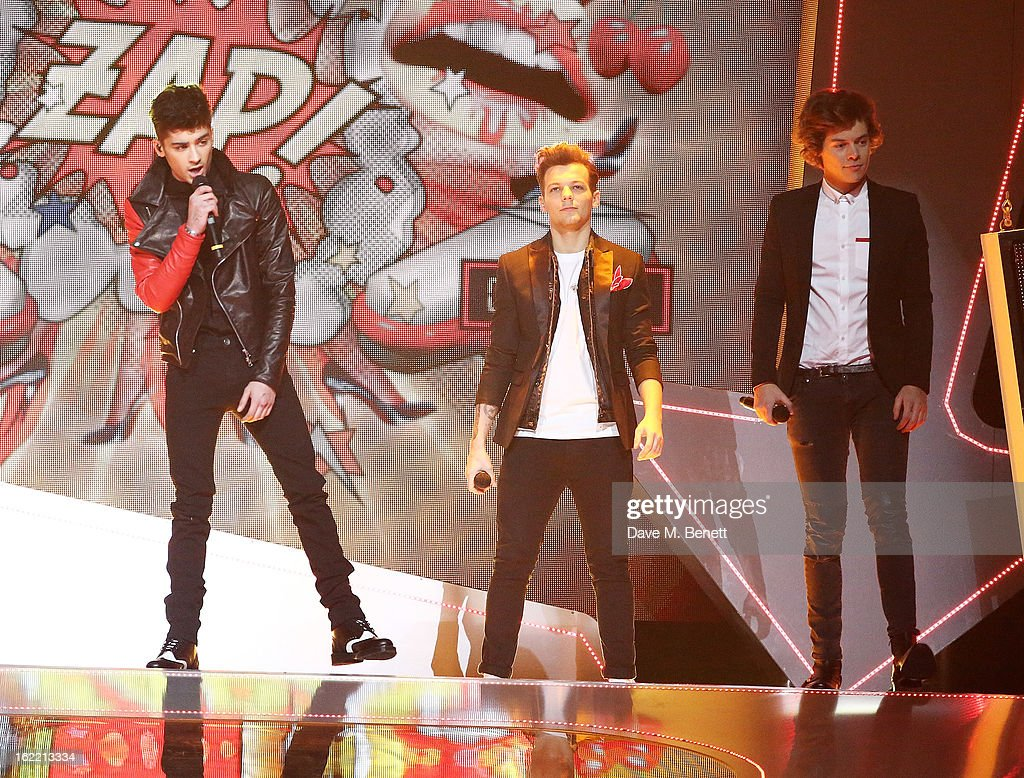 One Direction perform on stage at the Brit Awards at 02 Arena on February 20, 2013 in London, England.