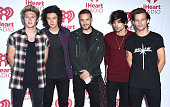 One Direction pose in the 2014 iHeartRadio Music Festival Night 2 Press Room at MGM Grand Garden Arena on September 20 2014 in Las Vegas Nevada
