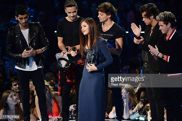 One Direction present The Best Pop Video award to Selena Gomez for 'Come and Get It' during the 2013 MTV Video Music Awards at the Barclays Center on...