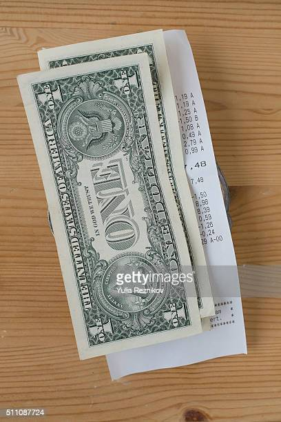 US one dollar and tip on the table