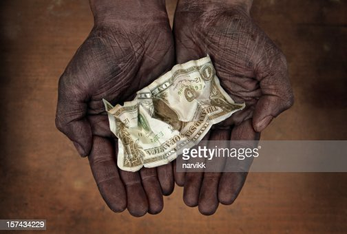 One Dollar Banknote in Human Hands