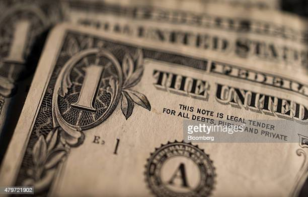 US one dollar bills are arranged for a photograph to illustrate the theme of risk in Oradell New Jersey US on Thursday June 18 2015 Photographer Ron...