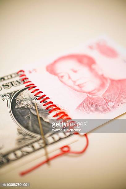 US One Dollar note stitched to Chinese 100 Yuan note, close-up