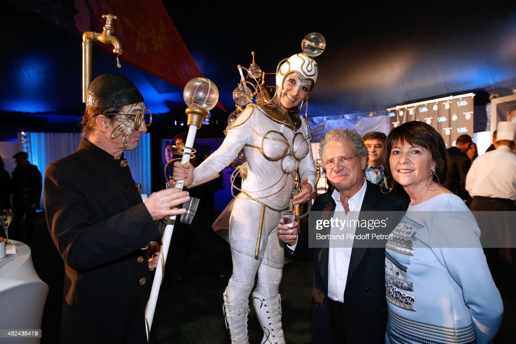 One Drop France Laurent Dassault and his wife Martine Dassault with actors of the Cirque attend the 'One Drop' Gala, held at Cirque du Soleil on November 28, 2013 in Paris, France.