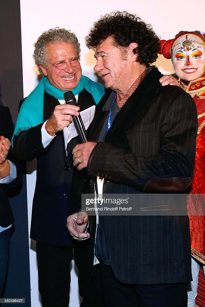 CEO One Drop France Laurent Dassault and singer Robert Charlebois attend the 'One Drop' Gala, held at Cirque du Soleil on November 28, 2013 in Paris, France.