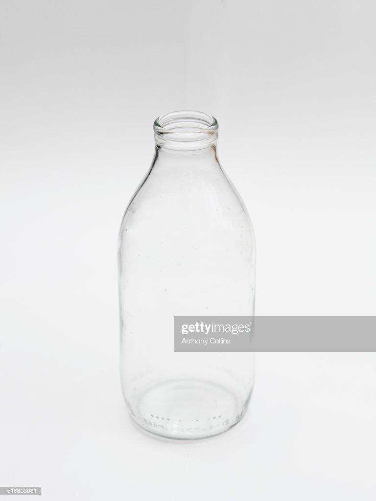 One empty milk bottle