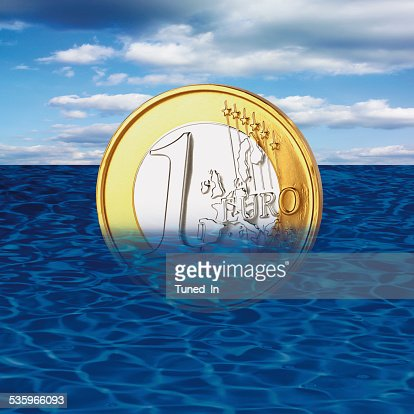 One euro coin drowning in sea, close-up : Stock Photo