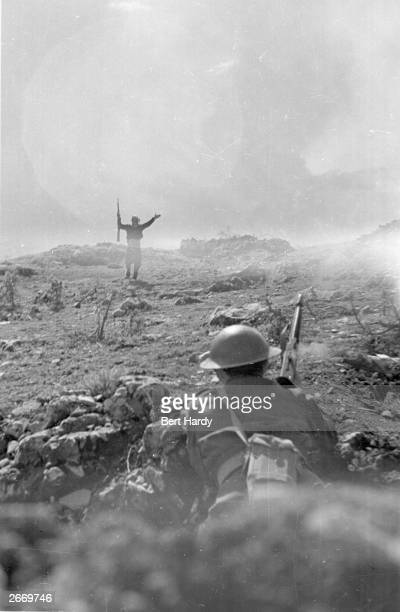 One exhausted guerrilla fighter surrenders to the Greek army during the Greek Civil War Original Publication Picture Post 4551 The War For Greece pub...