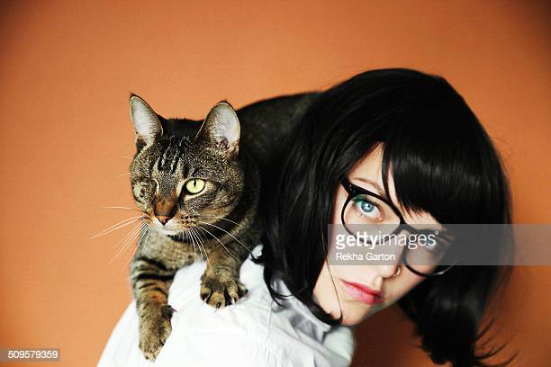 One eyed cat sitting on a woman's shoulders