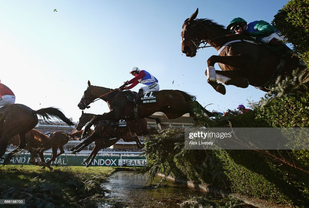 One For Arthur ridden by Derek Fox (22) clears the Water Jump on their way to victory in the 2017 Randox Health Grand National at Aintree Racecourse on April 8, 2017 in Liverpool, England.