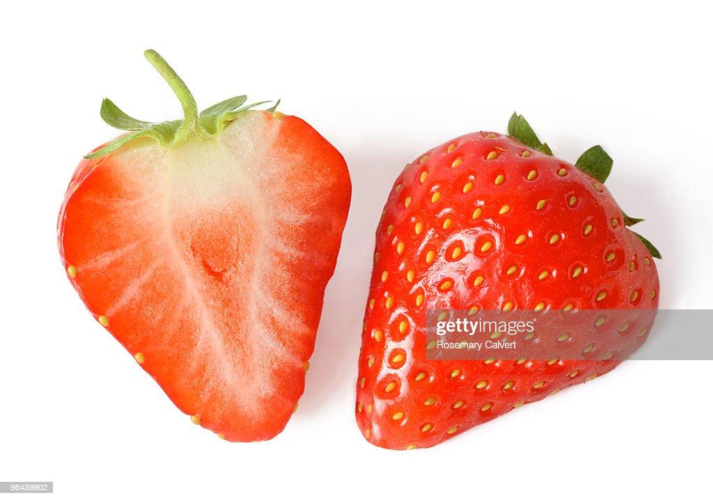 One fresh strawberry cut in half.