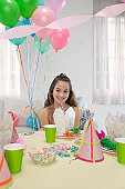 One Girl Sits at a Table to Celebrate a Birthday