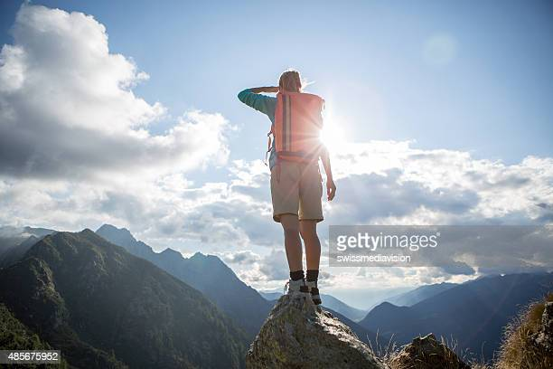 One hiker on mountain top looking at view