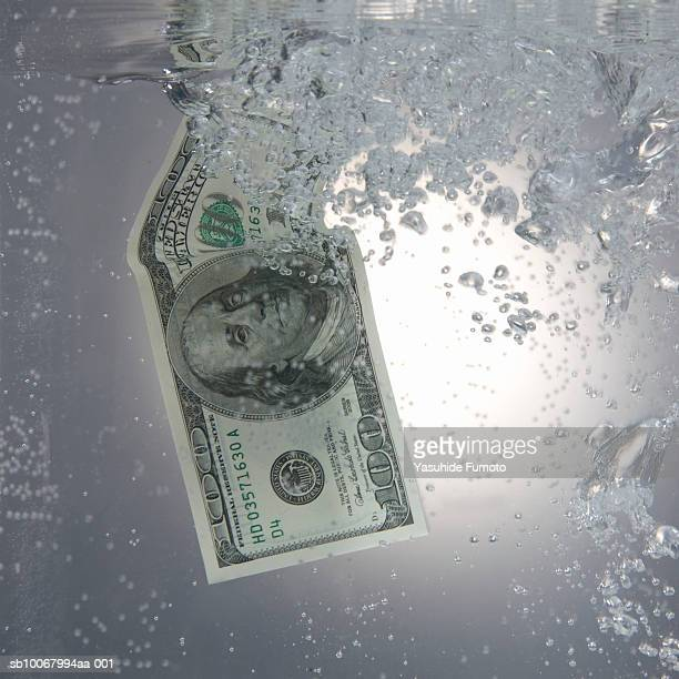 One hundred dollar bill in water