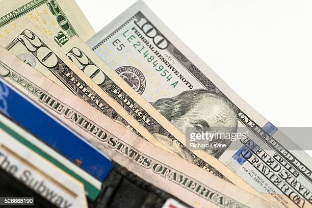 A US one hundred dollar bill with Benjamin Franklin is seen amongst other bills in New York on Friday February 19 2016 The US Treasury Dept is...