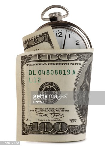 One hundred dollar bill wrapped around pocket watch