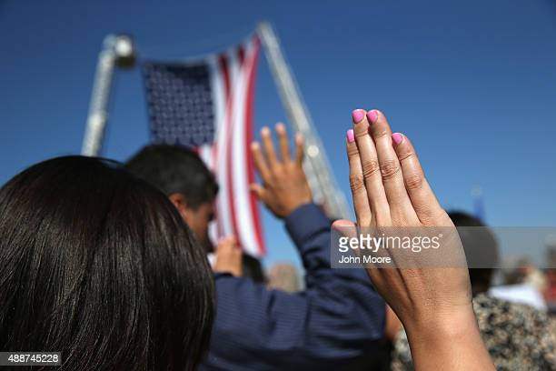 One hundred immigrants become American citizens during a naturalization ceremony at Liberty State Park on September 17 2015 in Jersey City New Jersey...